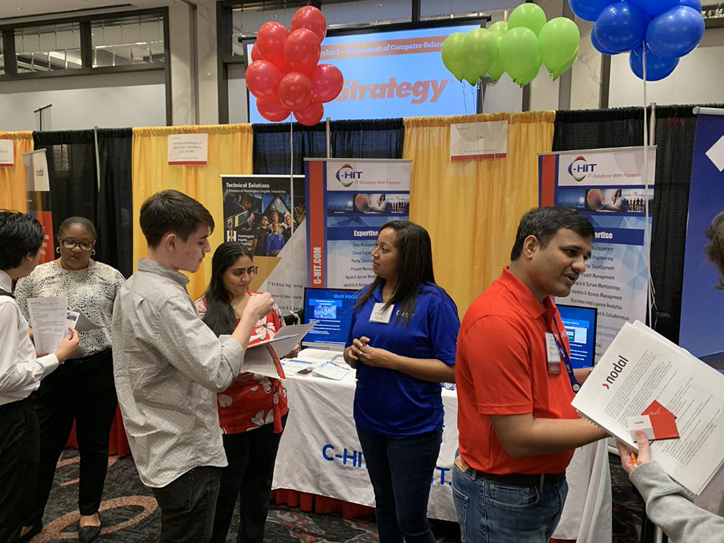 C-HIT employees providing information to job prospects during the University of Maryland College Park's job fair, 2020.