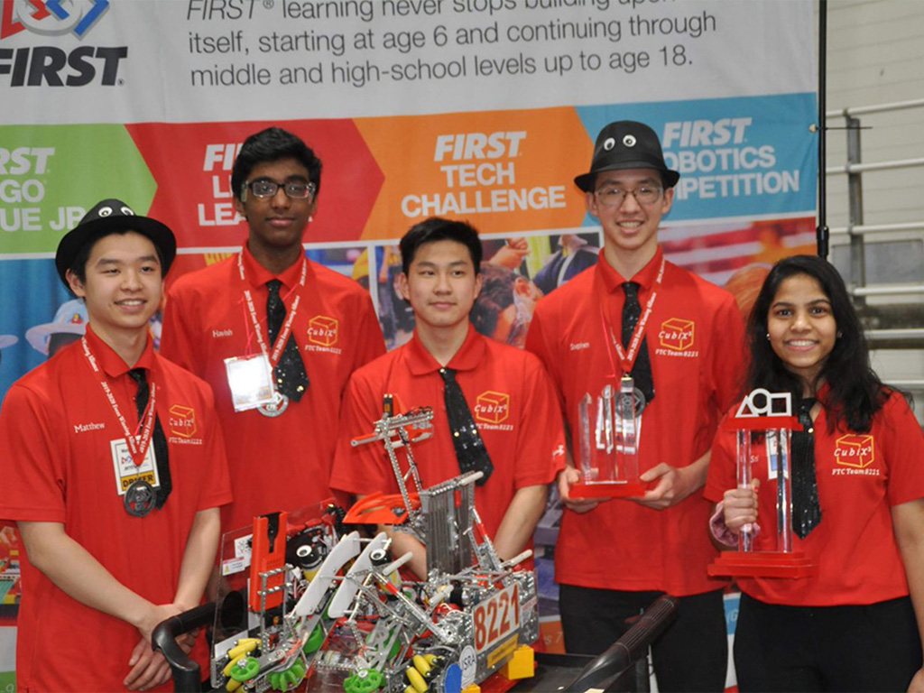 The C-HIT sponsored High School Robotics team (FTC Team 8221) pose with their competition entry and trophies, 2019.