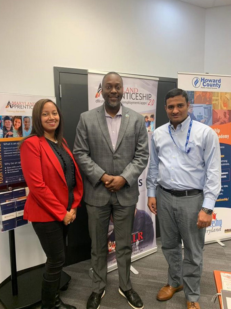 Members of C-HIT's HR team pose with Howard County Executive Calvin Ball at the Maryland Apprenticeship Fair, 2019.