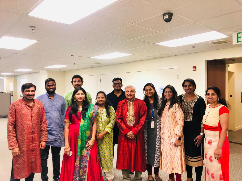 Employees celebrate Diwali, the Indian festival of lights, at C-HIT's corporate offices.