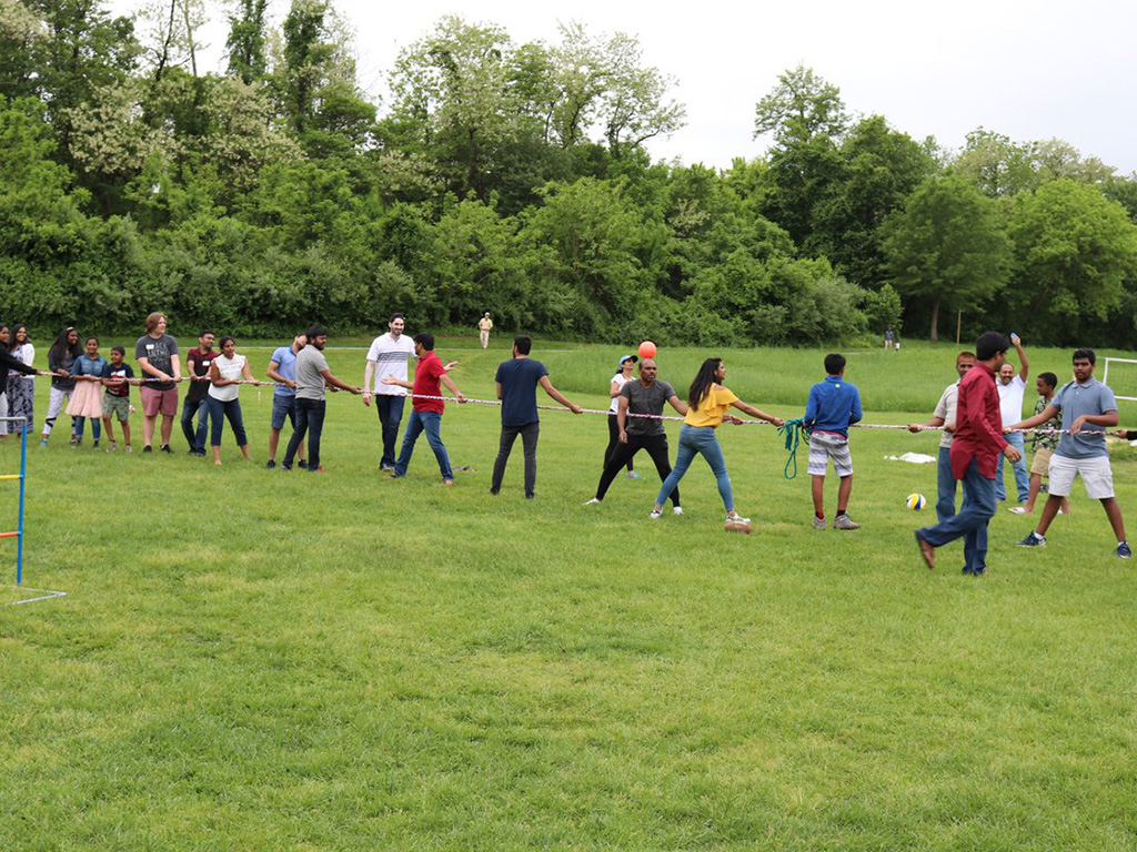 Employees playing a game of tug-o'-war at C-HIT's Family Picnic, 2019.