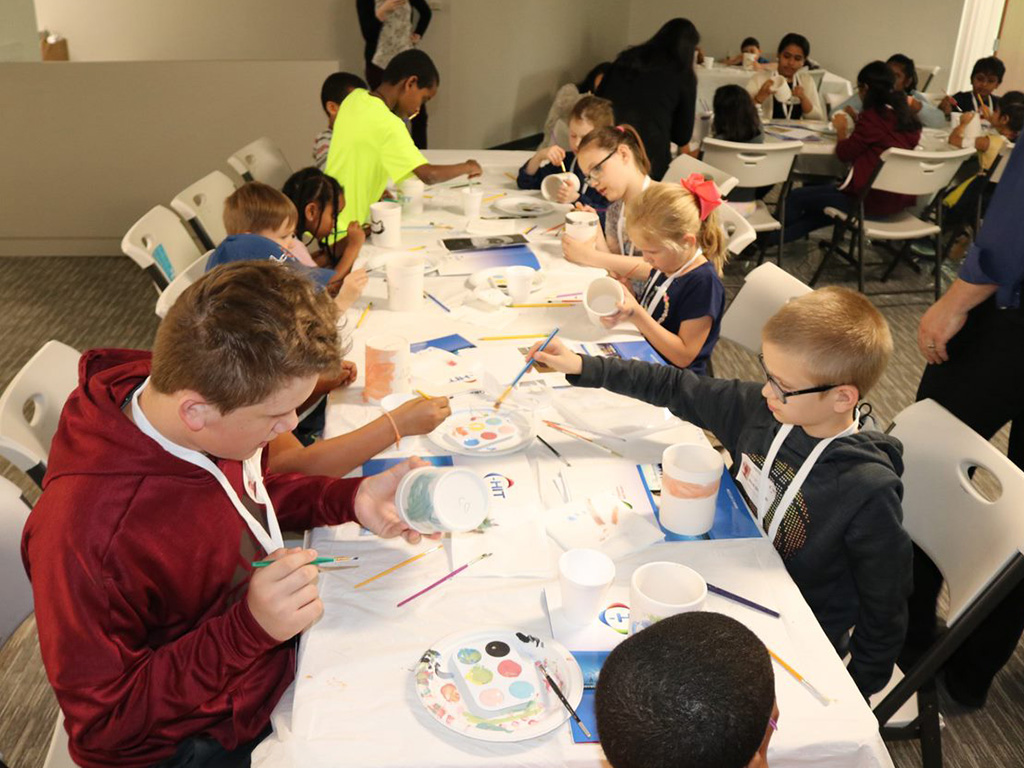 Staff member children involved in creative activities during C-HIT's Take Your Child to Work day, 2019.