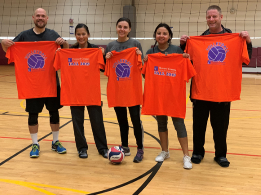 Members of the C-HITters volleyball team pose together after their play-off game.