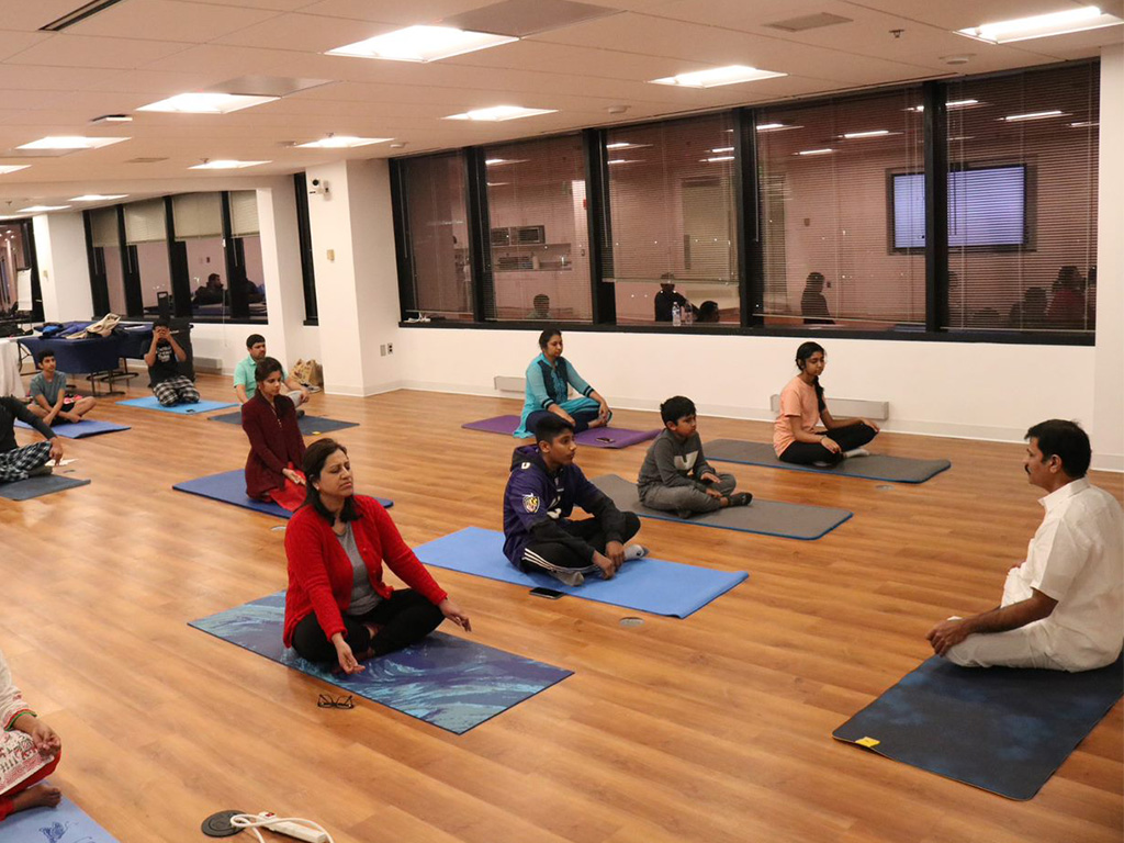 C-HIT employees attending a Yoga class at the corporate offices in Columbia, MD.