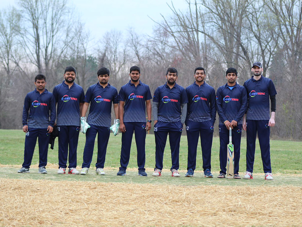 Members of the C-HITters Cricket team pose together for a picture.